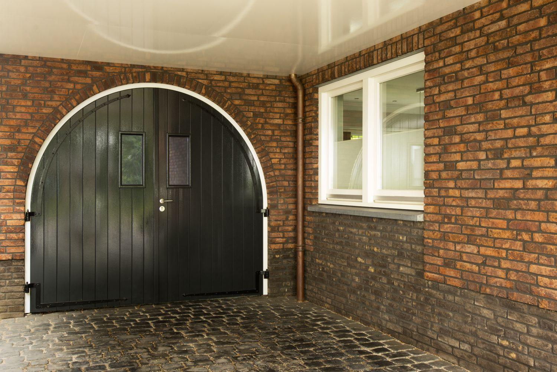rietgedekte villa carport architect